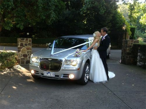 500 x 375 Mylimo - Hire a limo for your wedding day - Bride and Groom just Married
